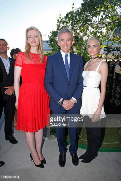 at the Inauguration of the exhibition 'Christian Dior Celebrates 70 Years of Creation' at the Musee des Arts Bernard Arnault and his daughter...