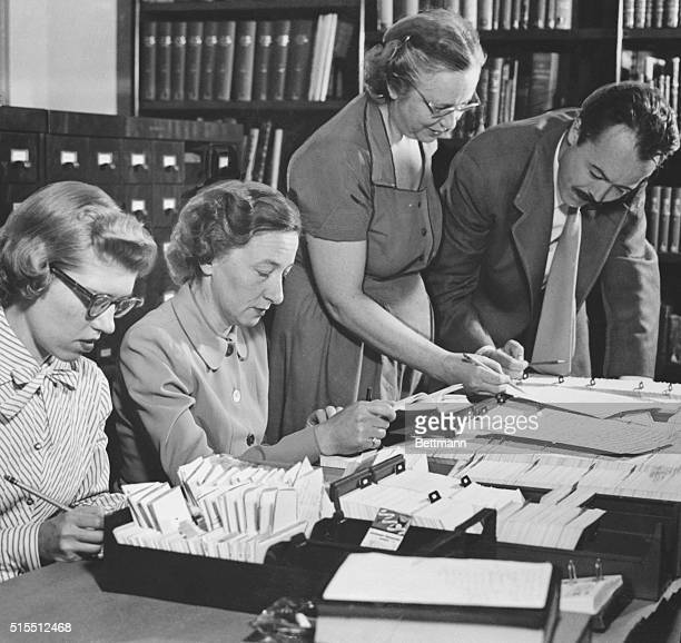 At the Institute of Sex Research bibliographical material for Dr Kinsey's book is gathered by aides Mrs Brown Mrs Collins Mrs Christenson and Dr Paul...