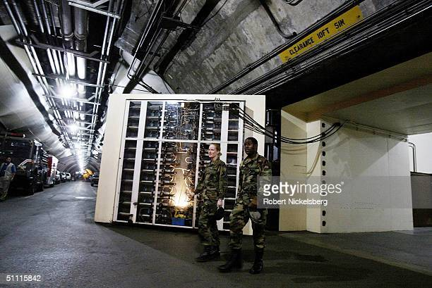 At the interior entrance to the Cheyenne Mountain Complex headquarters for NORAD two military personnel exit the administrative area May 11 2004 in...