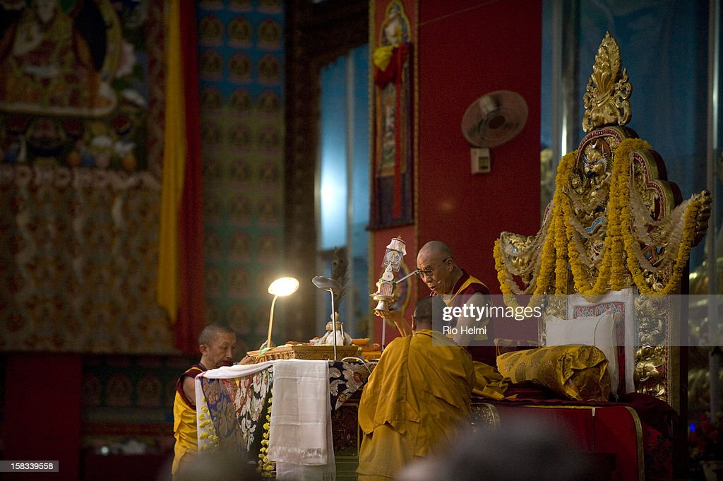 SETTLEMENT, MUNDGOD, KARNATAKA, INDIA - : At the Jangchub LamRim teachingds in South India in December 2012 attended by 20,000 devotees including more than two thousand foreigners from overseas, his Holiness the Dalai Lama confferring an initiation upon the 20,000 deveotees attending..