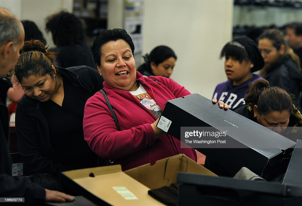 At the J.C. Penney store, Imelda Diaz of Landover, MD checks to find her size for some boots that normally sell for $65.00 but were on sale for $25.00. She was unable to find her size and left empty-handed.The J.C. Penney store opened at 6:00 am today in hopes that a Black Friday rush will help sales that have been sluggish of late. (Photo by Michael S. Williamson/The Washington Post via Getty Images