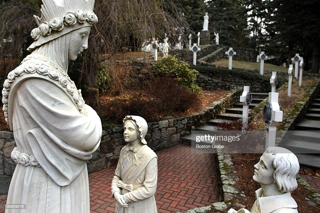 At The LaSalette Shrine, The Statue Of The Virgin Mary, Left, As She