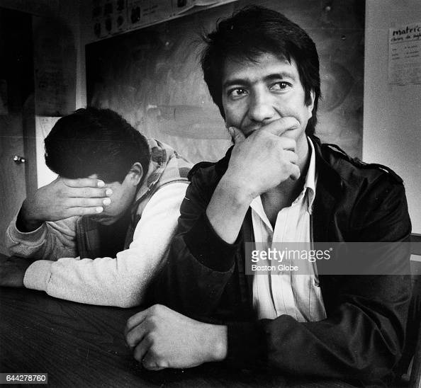 At the legal agency Centro Presente in Cambridge Mass two Salvadoran men talk about their jobs at Suffolk Downs in Boston on Oct 25 1988 They were...