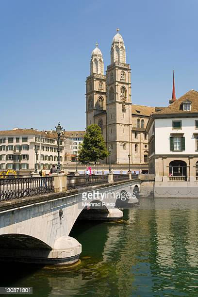 At the Limmat with the Grossmuenster Cathedral, Zurich, Switzerland