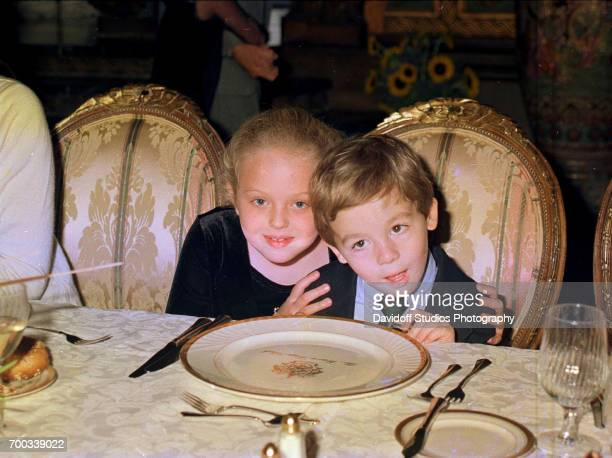At the MaraLago club sevenyearold Tiffany Trump poses with her cousin Robert Desmond as they pose together during a Thanksgiving dinner Palm Beach...
