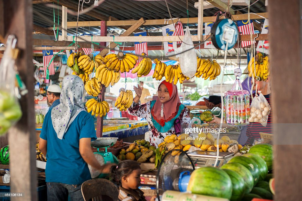 At the market in Dungun a small fishing town straddling the mouth of the Dungun river on peninsular Malaysia's east coast a predominantly Muslim...