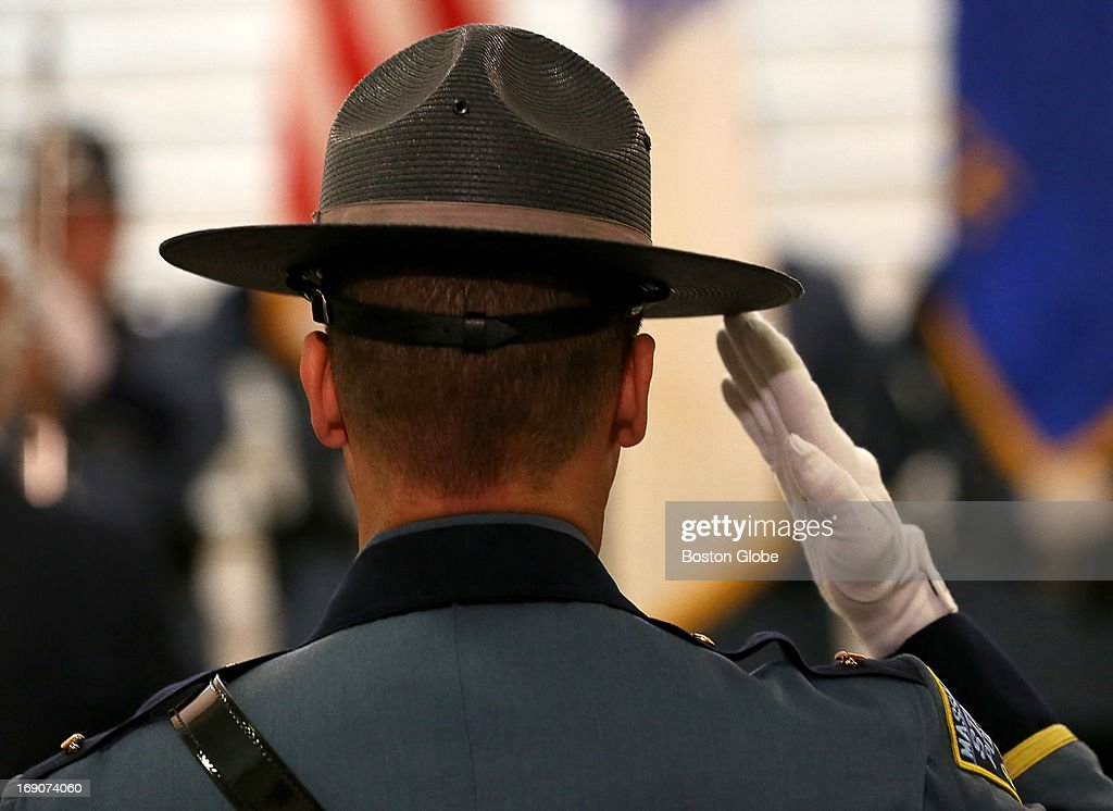 At the Massachusetts State Police Awards ceremony held at the State House, a Massachusetts State Trooper salutes during the playing of the National Anthem.