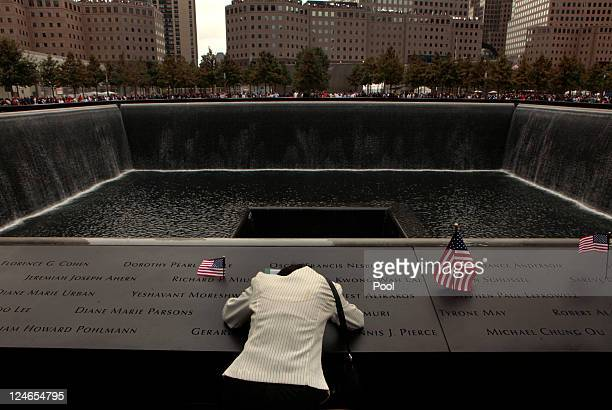 At the memorial pool Vasantha Velamuri mourns at the sight of her husband's name Sankara Sastry Velamuri who died in the World Trade Center during...