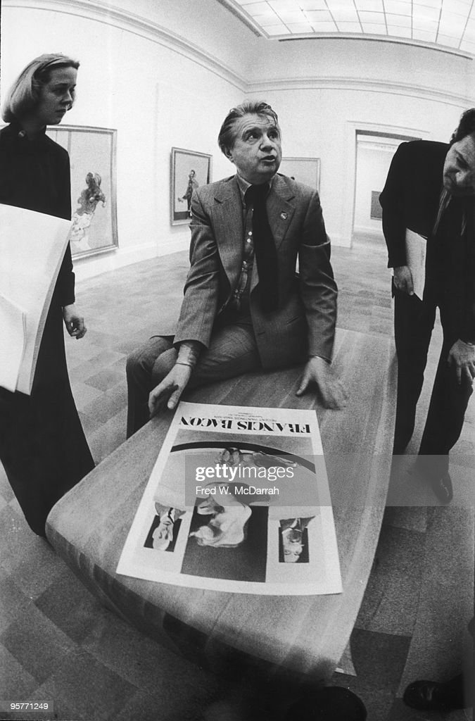 At the Metropolitan Museum of Art, Irish painter Francis Bacon (1909 - 1992) looks at the exhibition poster for a restrospective of his work, New York, New York, March 19, 1975.