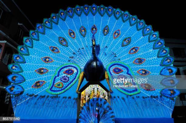 At the Monotosh Smritisangha Durga Puja in Rashbehari South Kolkata Indias national bird the peacock finds itself central to the pandals decorative...