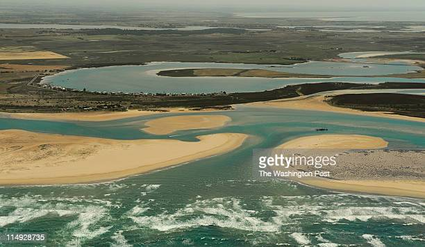 At the mouth of the Murray river water no longer flows directly into the sea blocked by sandbars exposed by low water levels