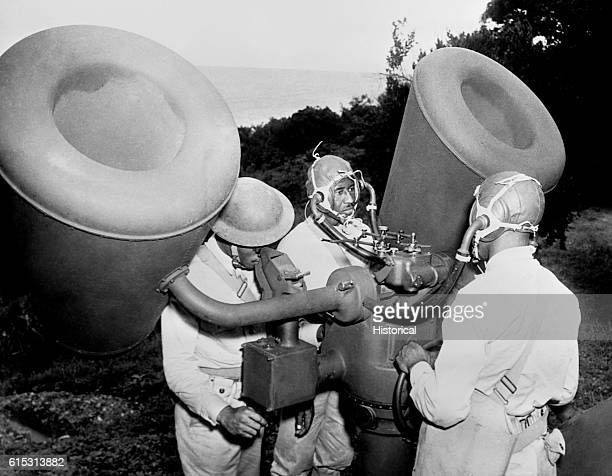 At the new US base in Trinidad men of a US Army antiaircraft unit are seen manning a listening device which records the sound of airplane engines Ca...
