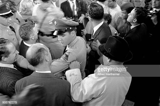 Alfred Wertheimer/Getty Images At the New York Port of Embarkation's Brooklyn Army Terminal American musician Elvis Presley and his manager Colonel...