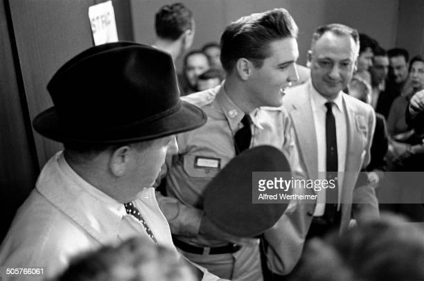 Alfred Wertheimer/Getty Images At the New York Port of Embarkation's Brooklyn Army Terminal American musician Elvis Presley talks to the press before...