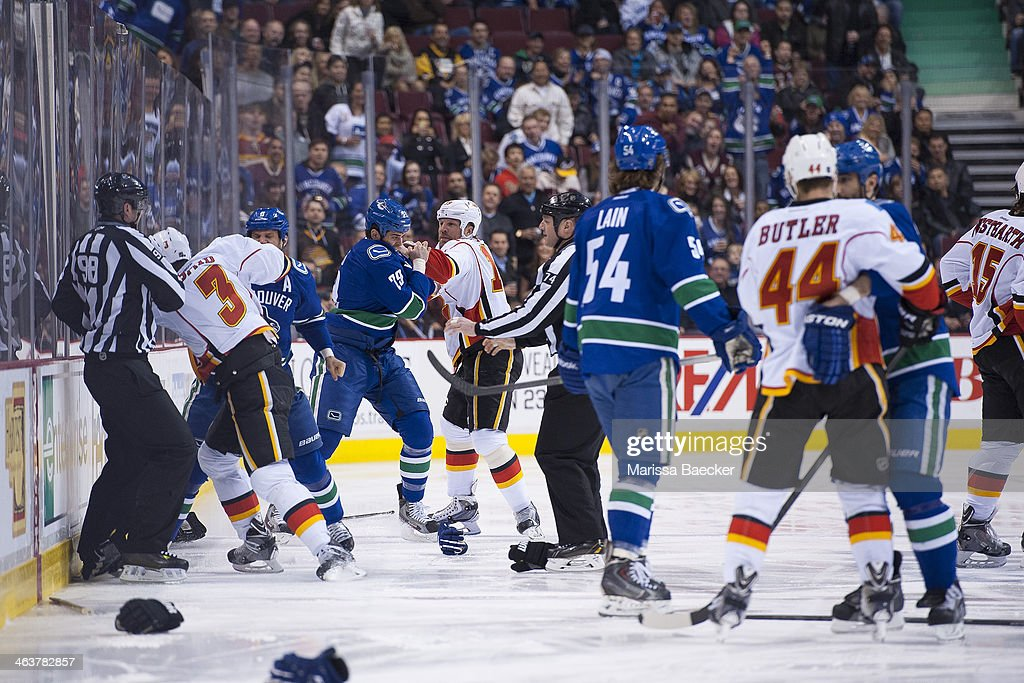 At the opening face off between the Vancouver Canucks and the Calgary Flames, both teams lines drop the gloves. <a gi-track='captionPersonalityLinkClicked' href=/galleries/search?phrase=Kevin+Bieksa&family=editorial&specificpeople=688792 ng-click='$event.stopPropagation()'>Kevin Bieksa</a> #3 of the Vancouver Canucks takes on Ladislav Smid #3 of the Calgary Flames while <a gi-track='captionPersonalityLinkClicked' href=/galleries/search?phrase=Tom+Sestito&family=editorial&specificpeople=4067117 ng-click='$event.stopPropagation()'>Tom Sestito</a> #29 of the Vancouver Canucks gets tangled with <a gi-track='captionPersonalityLinkClicked' href=/galleries/search?phrase=Brian+McGrattan&family=editorial&specificpeople=598177 ng-click='$event.stopPropagation()'>Brian McGrattan</a> #16 of the Calgary Flames after Chris Butler #44 of the Calgary Flames wraps up fighting with <a gi-track='captionPersonalityLinkClicked' href=/galleries/search?phrase=Jason+Garrison&family=editorial&specificpeople=2143635 ng-click='$event.stopPropagation()'>Jason Garrison</a> #5 of the Vancouver Canucks and Kellan Lain #54 of the Vancouver Canucks looks on after fighting with <a gi-track='captionPersonalityLinkClicked' href=/galleries/search?phrase=Kevin+Westgarth&family=editorial&specificpeople=4537296 ng-click='$event.stopPropagation()'>Kevin Westgarth</a> #15 of the Calgary Flames on January 18, 2014 at Rogers Arena in Vancouver, British Columbia, Canada.