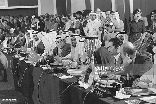 At the opening of the OPEC oil ministers 48th meeting here 12/15 Saudi Arabian oil minister Sheikh Yamani peers inquisitively at the other delegates...