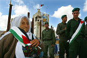 At the Palestinian headquarters in Ramallah West Bank Yasser Arafat's death is mourned by soldiers visitors at his tomb Um Abed a local elderly lady...
