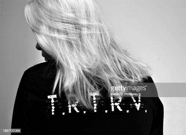 At the Panzerfaust Records office Wendy Smith wears a 'Final War' tshirt which reads the band's motto TRTRV on November 19 2004 in St Paul Minnesota...