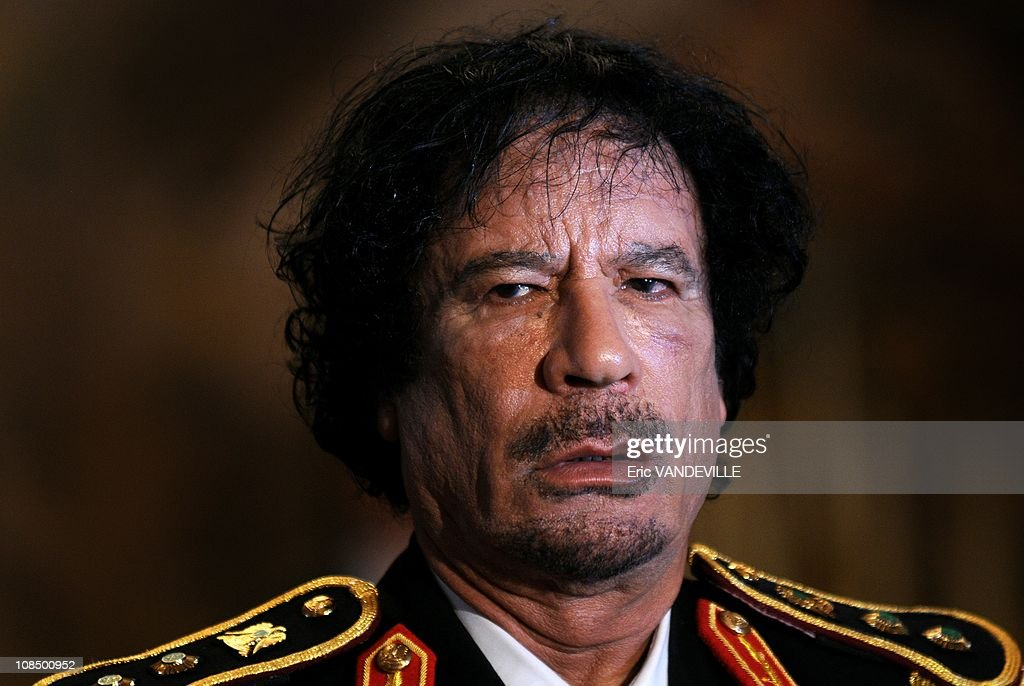 At the Quirinale Palace , Libyan leader Moammar Gadhafi has hailed a 'new era' in relations with Italy during his first visit to his country's former colonial ruler. When he arrived in Rome he brazenly wore a picture of a legendary Lybian resistance hero Omar Al-Mukhtar in chains alongside his Italian captors and hanged in 1931.