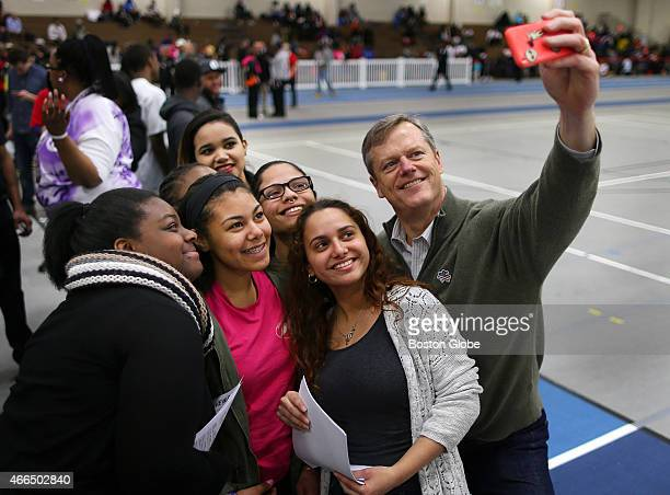 At the Reggie Lewis Tack where the third Annual 'Got Peace' Basketball Tournament was held Governor Charlie Baker takes a selfie with students from...