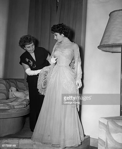 At the Savoy Hotel Britishborn American actress Elizabeth Taylor is helped by her mother Sara Sothern to dress for the Royal Command Film Performance...