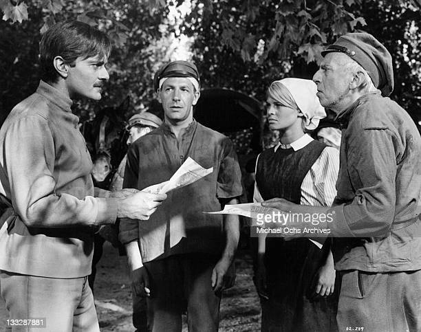 At the site of the country hospital Omar Sharif reads news of the Tsar's imprisonment to Bernard Kay Julie Christie and Erik Chitty in a scene from...