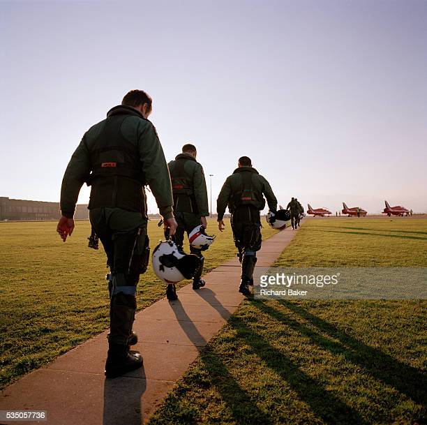 At the start of another day's work pilots belonging to the elite 'Red Arrows' Britain's prestigious Royal Air Force aerobatic team walk in singlefile...