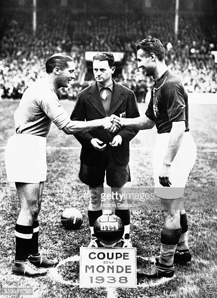 At the start of the 1938 World Cup Final in Paris between winners Italy and Hungary Italy's Meazza and Hungarian team captain Sarosi shake hands as...