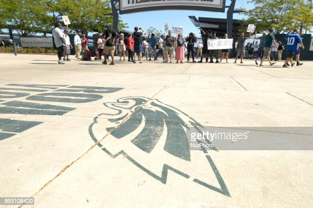 At the start of the game protestors take a knee in support of the movement started by NFL player Colin Kaepernick outside Lincoln Financial Field in...