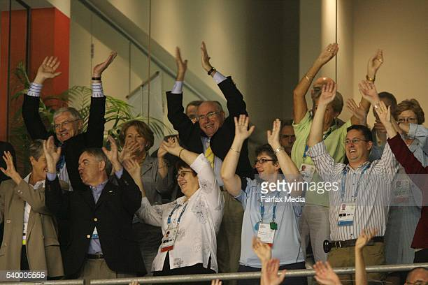 NETBALL at the State Hockey and Netball Centre Prime Minister John Howard and his wife Janette wave their arms in the air during the quartertime...