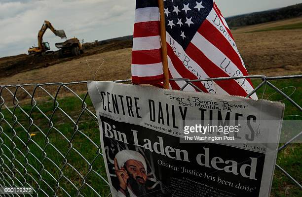 At the temporary Flight 93 Memorial site near Shanksville a newspaper and flag was mounted on the fence that surrounds that field where Flight 93...