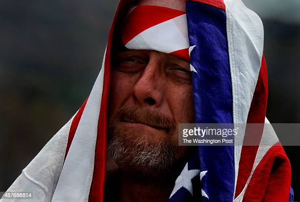 At the temporary Flight 93 Memorial site near Shanksville PA Jeff Ray of Stoney Creek Pa fights emotions as he looks out over the field where Flight...