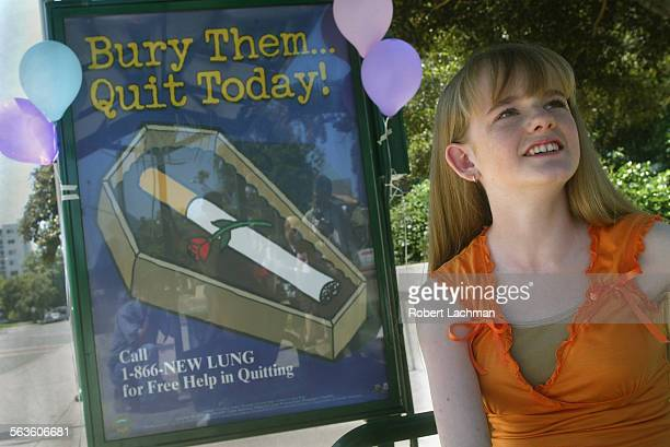 At the unveiling ceremony for the bus shelter anti–tabacco artwork Chelsea Clark a student at the Orange County High School of the Art is...