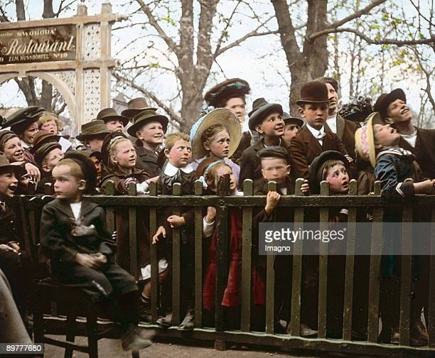 At the Viennese Wurstelprater Vienna Photograph probably by Emil Mayer Handcolored lantern slide Around 19051910