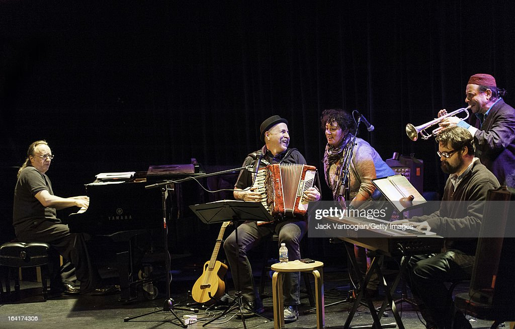 At the World Music Institute's Global Salon Series 'Zmiros Project: New Jewish Mystical Music' concert, from left, Rob Schwimmer on piano, Lorin Sklamberg on accordion and vocals, guest vocalist Sarah Gordon, Michael Winograd on keyboards, and Frank London on trumpet, perform at the Symphony Space's Thalia Theater, New York, New York, February 6, 2013.
