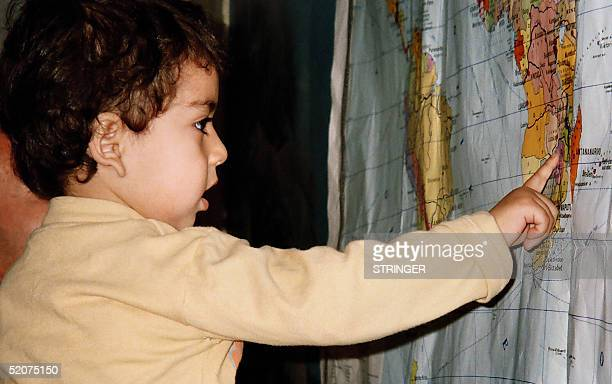 STORY 'At two Azeri toddler has found his way in the world' This picture dated 27 January 2005 shows 2yearold Ayhan Abdullayev looking at the World...