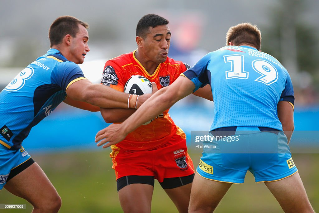 Ata Hingano of the Warriors is tackled during the NRL Trial Match between the New Zealand Warriors and the Gold Coast Titans at Toll Stadium on February 13, 2016 in Whangarei, New Zealand.