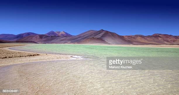 Atacama Green Lagune and Andean summits around it
