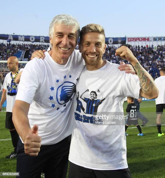 Atalanta BC coach Gian Piero Gasperini and Alejandro Dario Gomez celebrate the qualification at UEFA Europa League 2017/18 at the end of the Serie A...