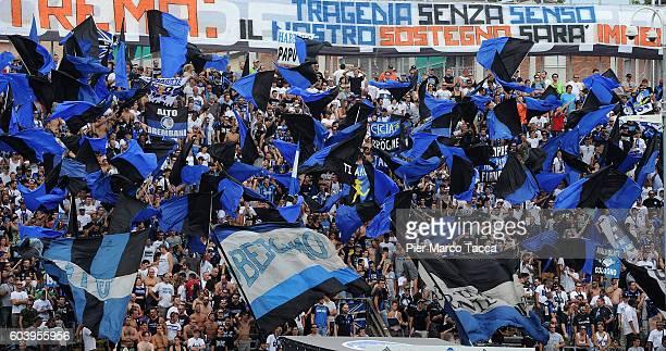 Atalanta fans waving flags during the Serie a match between Atalanta BC and FC Torino at Stadio Atleti Azzurri d'Italia on September 11 2016 in...