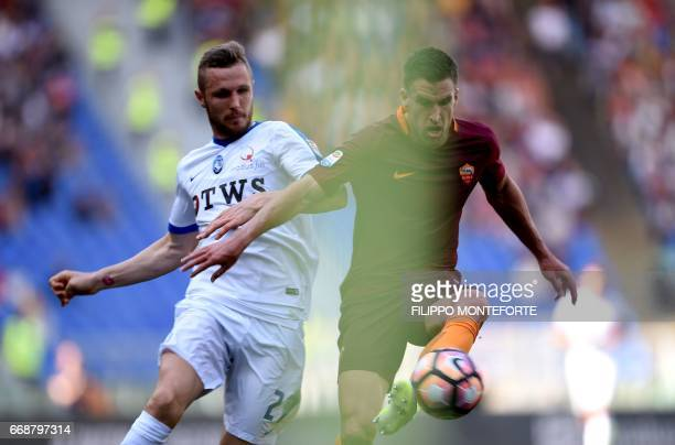 Atalanta midfielder from Slovenia Jasmin Kurtic vies with Roma's midfielder from Netherlands Kevin Strootman during the Italian Serie A football...