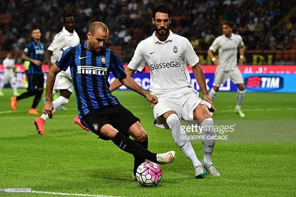 Atalanta midfielder from Spain Suso fights for the ball with Inter Milan's forward from Argentina Rodrigo Palacio during the Italian Serie A football...