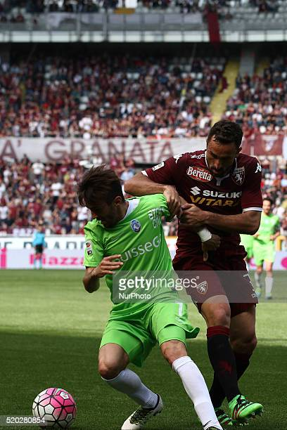 Atalanta midfielder Marco D'Alessandro fights for the ball against Torino defender Cristian Molinaro during the Serie A football match n32 TORINO...