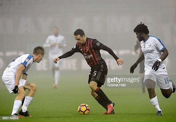 Atalanta4S midfielder from Ivory Coast Franck Kessie and defender Andrea Conti from Italy vie with AC Milan midfielder from Italy Giacomo Bonaventura...