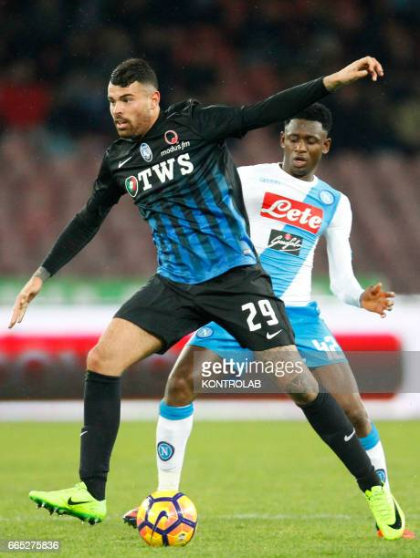 Atalanta'a Italian forward Andrea Petagna fights for the ball with Napoli's Guinean midfielder Amadou Diawara during the Italian Serie A football...