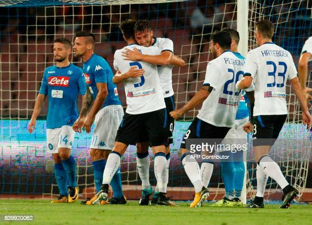 Atalanta'a Italian midfielder Bryan Cristante celebrates after scoring a goal with teammates during the Italian Serie A football match SSC Napoli vs...