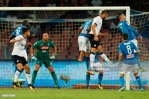 Atalanta'a Italian midfielder Bryan Cristante heads the ball to score during the Italian Serie A football match SSC Napoli vs Atalanta BC on August...