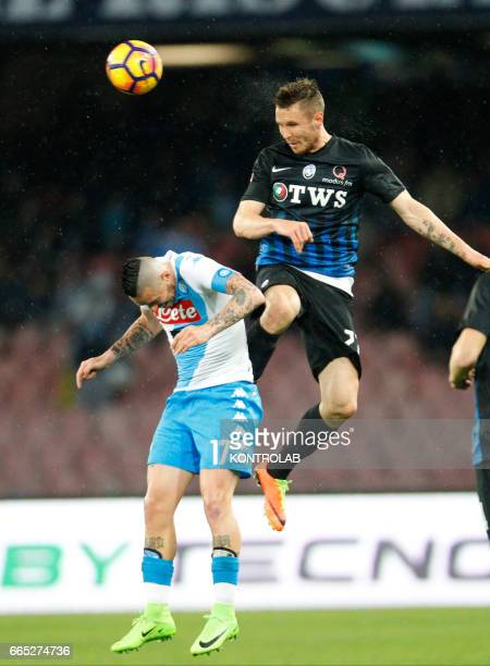 Atalanta'a Slovenian midfielder Jasmin Kurtic fights for the ball with Napoli's Slovakian midfielder Marek Hamsik during the Italian Serie A football...