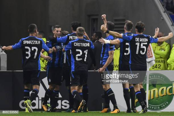Atalanta's Argentinian forward Alejandro Gomez celebrates with teamates after scoring a goal during the Europa League football match between...