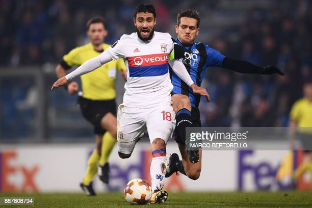 Atalanta's Brazilian defender Rafael Toloi vies with Lyon's forward Nabil Fekir during the UEFA Europa League group E football match Atalanta vs...